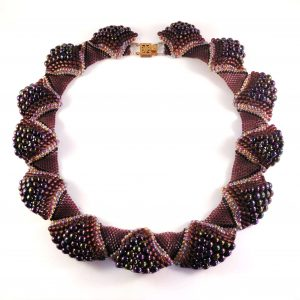 Use a variety of seed bead sizes, types and colours to create the undulating texture of this unique statement necklace called the Ruffled Collar.