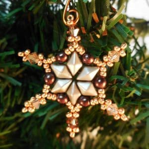 Make your own sparkling Holiday decorations with this beaded Snowflake Ornament tutorial! This simple snowflake beading pattern is quick and easy.