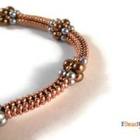Create the delicate Mixed Metals Bracelet using a combination of seed beads and pearls. This free bracelet pattern teaches Tubular Herringbone Stitch.